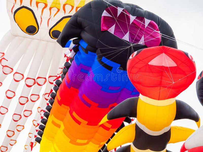 Pasir Gudang World Kite Festival 2018. Pasir Gudang, Malaysia - March 3, 2018: Large, soft kites flying at the Pasir Gudang World Kite Festival in the Johor stock photos