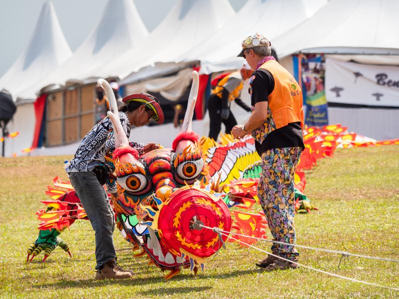 Pasir Gudang World Kite Festival 2018. Pasir Gudang, Malaysia - March 3, 2018: Large kite train in traditional, Indonesian dragon style being prepared for take stock photography