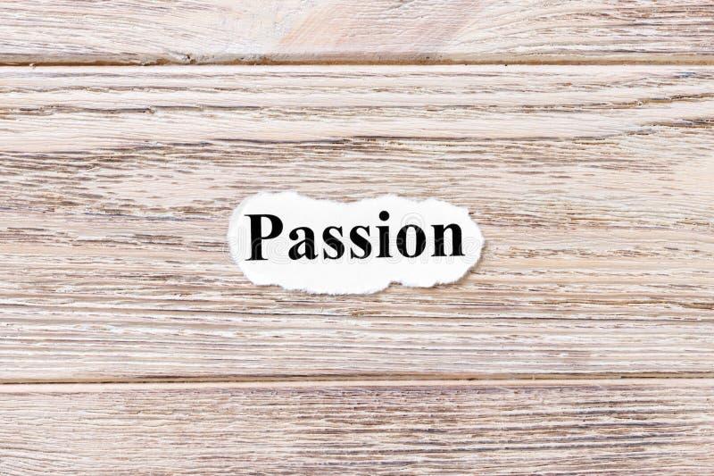 Pasja słowo na papierze Pojęcie Słowa pasja na drewnianym tle obrazy stock