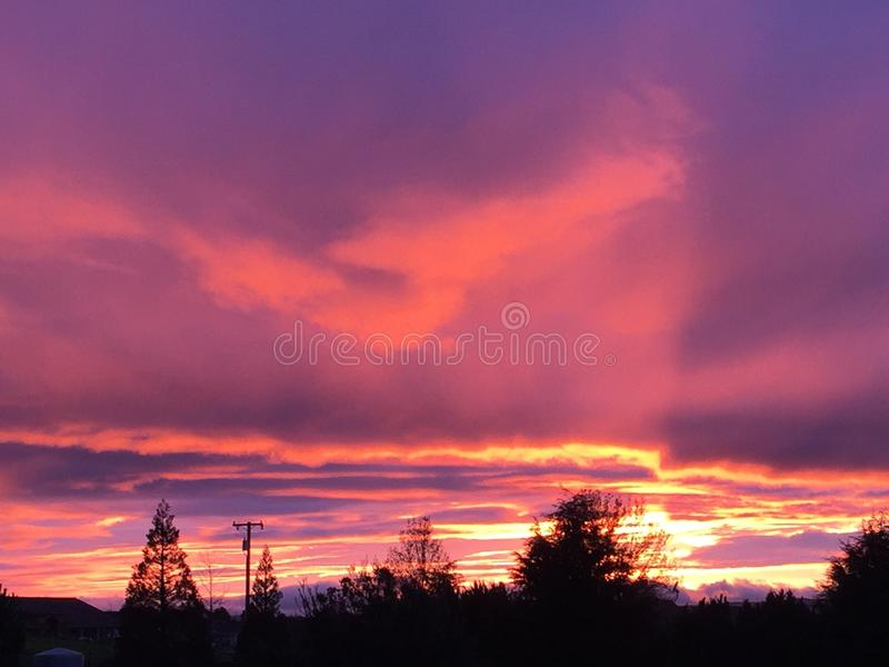 Paso Robles wine country sunset. Purple pink gorgeous California winter sunset from a rural ranch during a storm royalty free stock photos