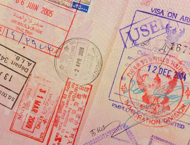 Paspoort met de zegels van Thai en van Hongkong stock afbeeldingen