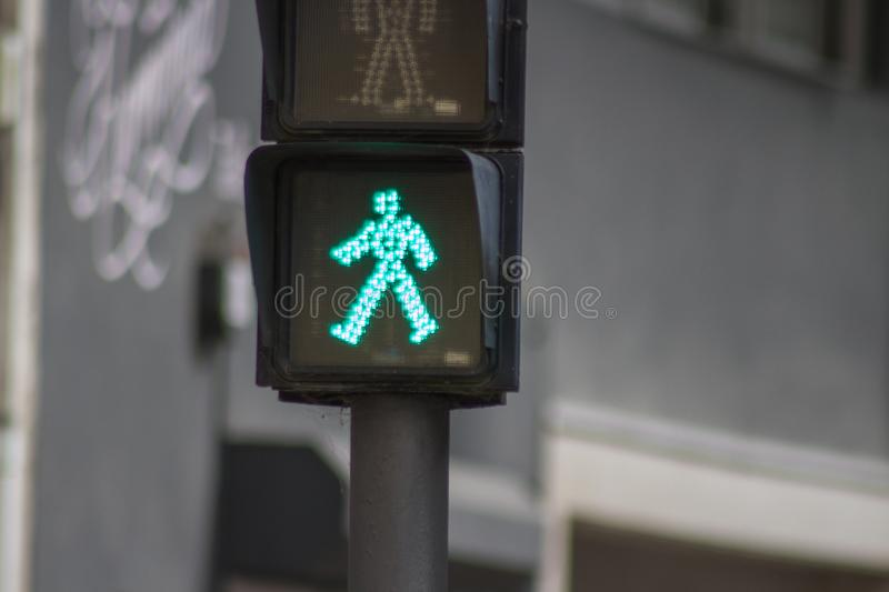 Pass pedestrians. Is green the traffic light allows us to pass safely stock photography