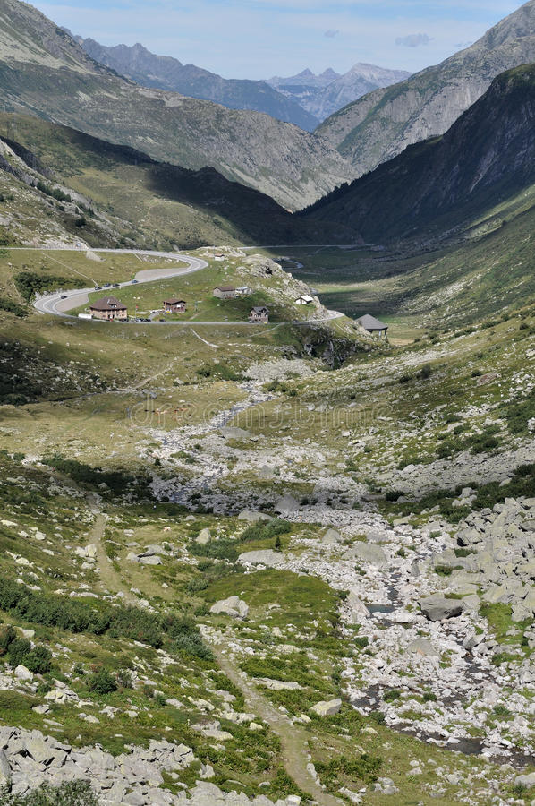 Pass road toward north, gottardo. Landscape, looking toward north, of the high valley in swiss alps in sunny summer day royalty free stock images