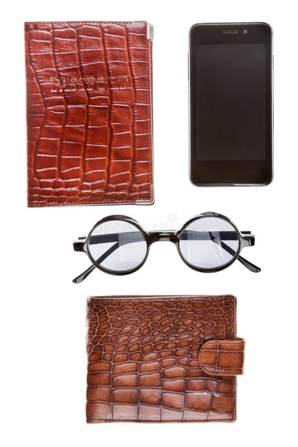 Pass, telefon, exponeringsglas och brun plånbok som isoleras på vit bakgrund royaltyfria foton