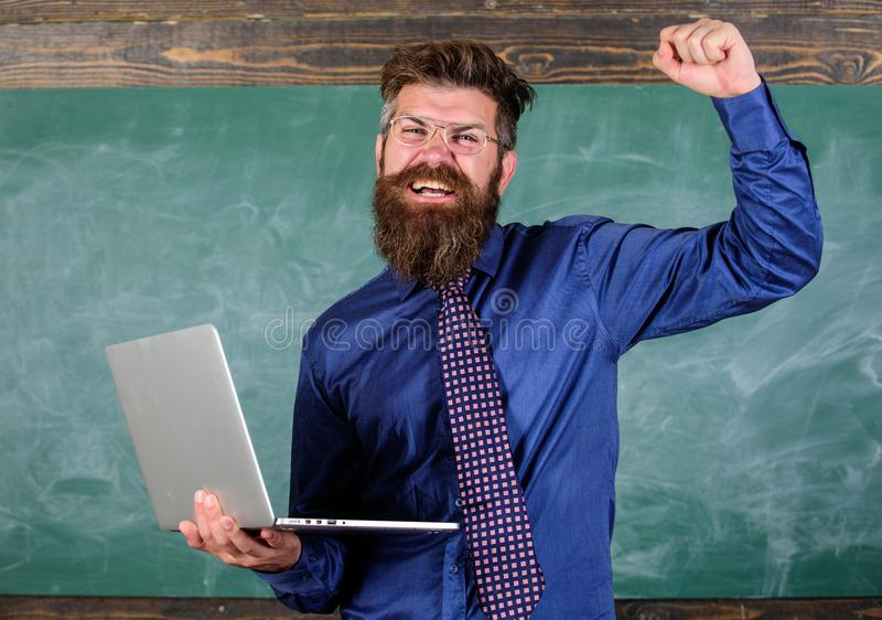 Pass test online. Distance education concept. Teacher bearded man with modern laptop passed test online chalkboard. Background. Hipster teacher eyeglasses holds royalty free stock photos