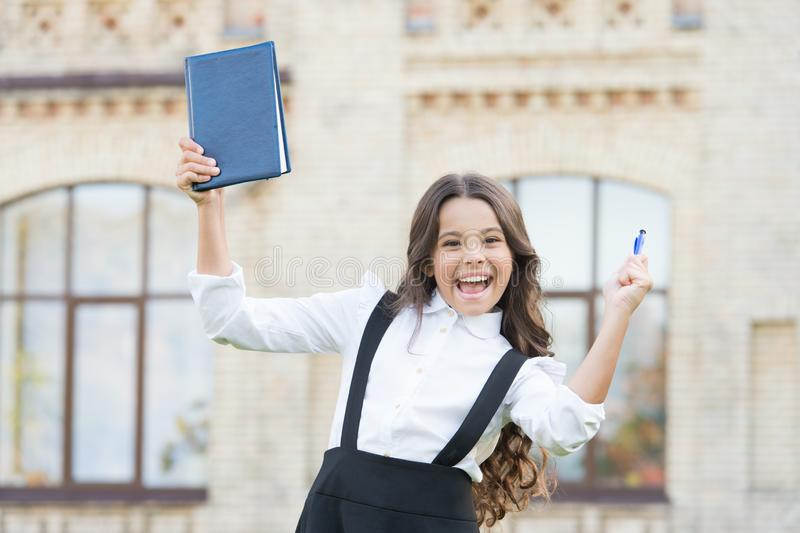 Pass test successfully. Little girl school student. School education concept. Knowledge day. Learning language. Best. Textbooks for learning at home. Hooked on royalty free stock photos
