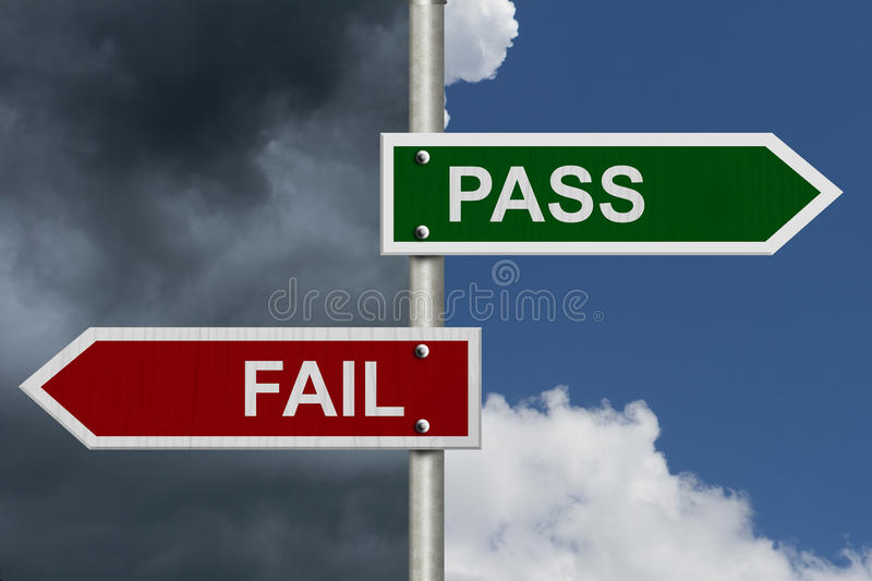 Pass versus Fail. Red and Green street signs with blue and stormy sky with words Pass and Fail, Pass versus Fail royalty free stock photos