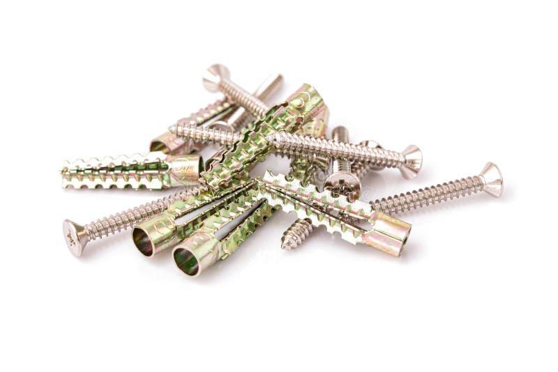 Passadores do metal ou âncoras e parafusos metálicos da expansão imagens de stock royalty free