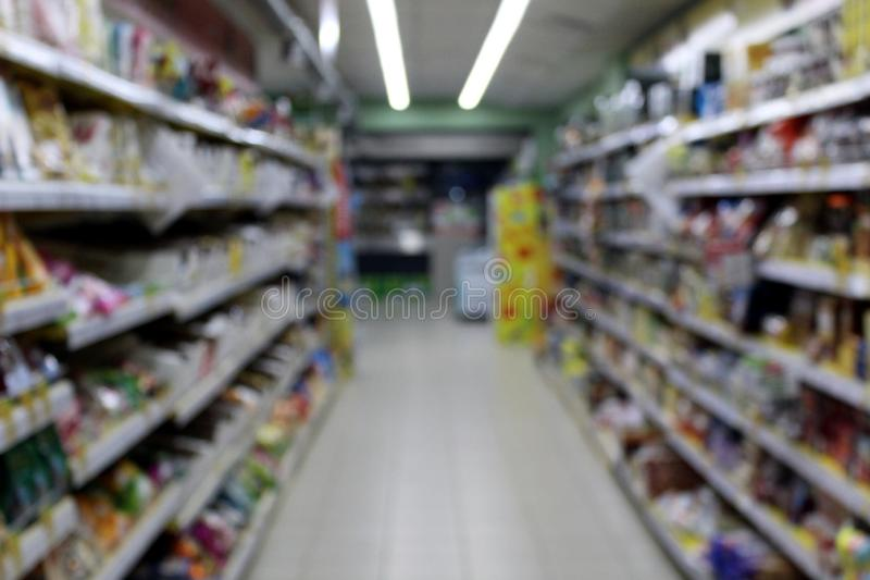 Blurred photo of consumer goods in a supermarket grocery store. Passage, background picture,, blur, blurred, boke, work, buy, choice, color, shopping, consumer royalty free stock image
