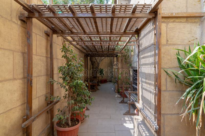 Passage ceiled with wooden pergola leading to the historical House of Egyptian Architecture from the Mamluk era, Cairo, Egypt. Passage ceiled with wooden pergola stock photo