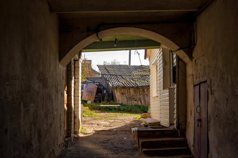 The passage into the courtyard inside the old house stock photography