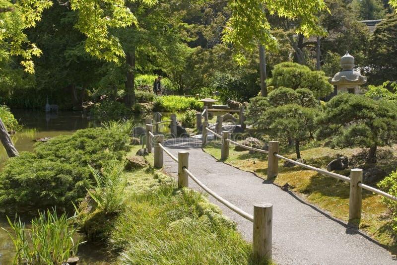 Passage couvert de jardin de thé photographie stock