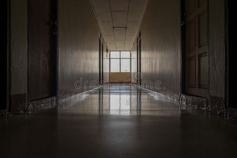 A passage in the dorm did not turn on electric lamps making it the dark atmosphere is depressing. And alarming royalty free stock images