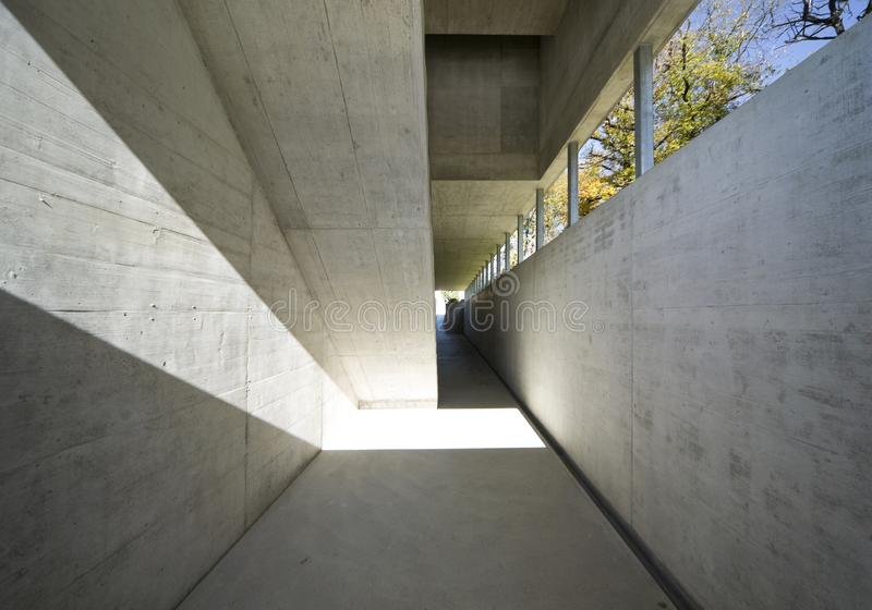 Passage in an external cement corridor royalty free stock photo