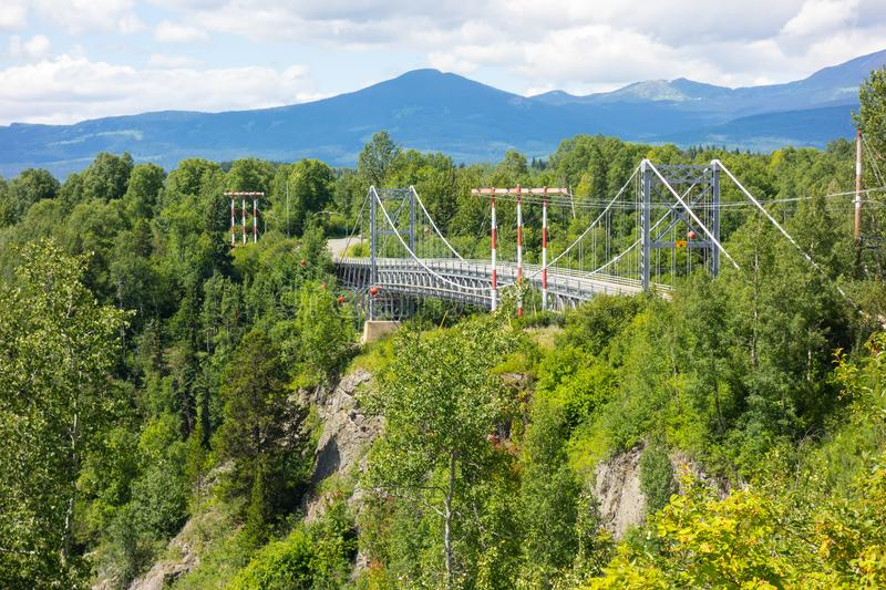 An impressive bridge in the yukon territories. Passage over a steep canyon as seen in northern canada royalty free stock images