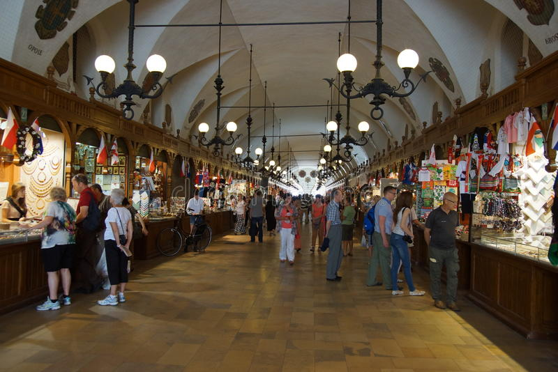 Passage with souvenir stalls of the gothic hall Sukiennice, Main Market Square, Krakow royalty free stock image