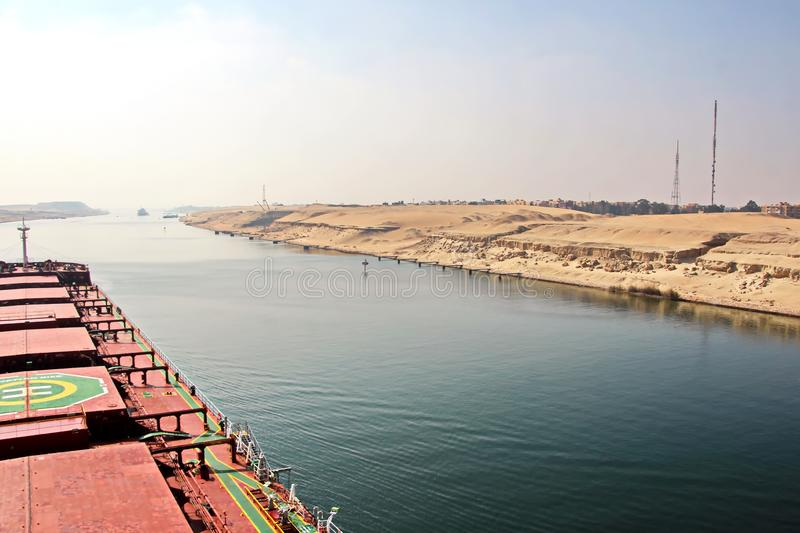 Passage through the Suez Canal by large sea vessels. royalty free stock images