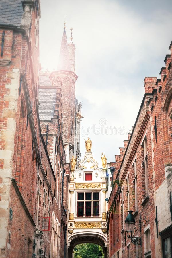 Passage to the Burg square in Bruges between the town hall on th. E left and the ancient civil registry on the right, Belgium stock photos