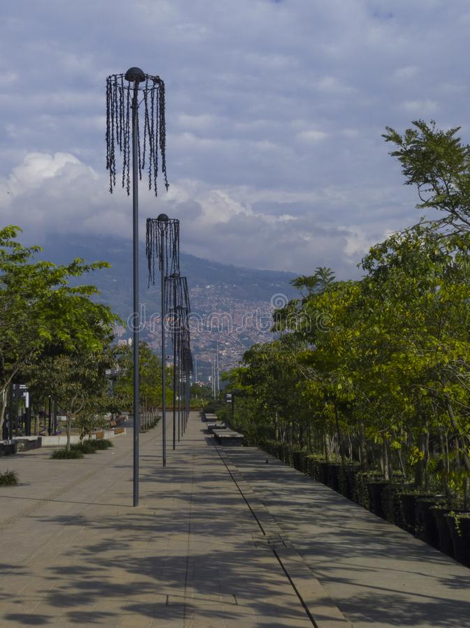 Passage to walk in Medellin river parks with summer sun royalty free stock image
