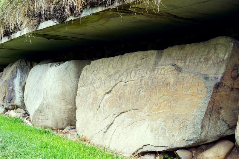 Massive stones with prehistoric carvings. The passage tomb at Newgrange known as Brú na Bóinne in Gaelic served as a focus of ceremonial activity in the stock photos
