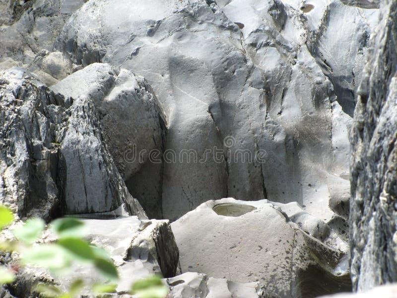 Passage van tijd op de rots stock foto