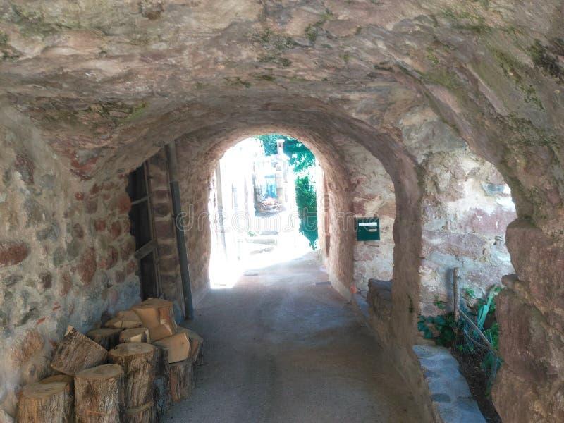 Tunnel House. Passage passage way way path transit bit gorge Stone wall stone Log stock photo