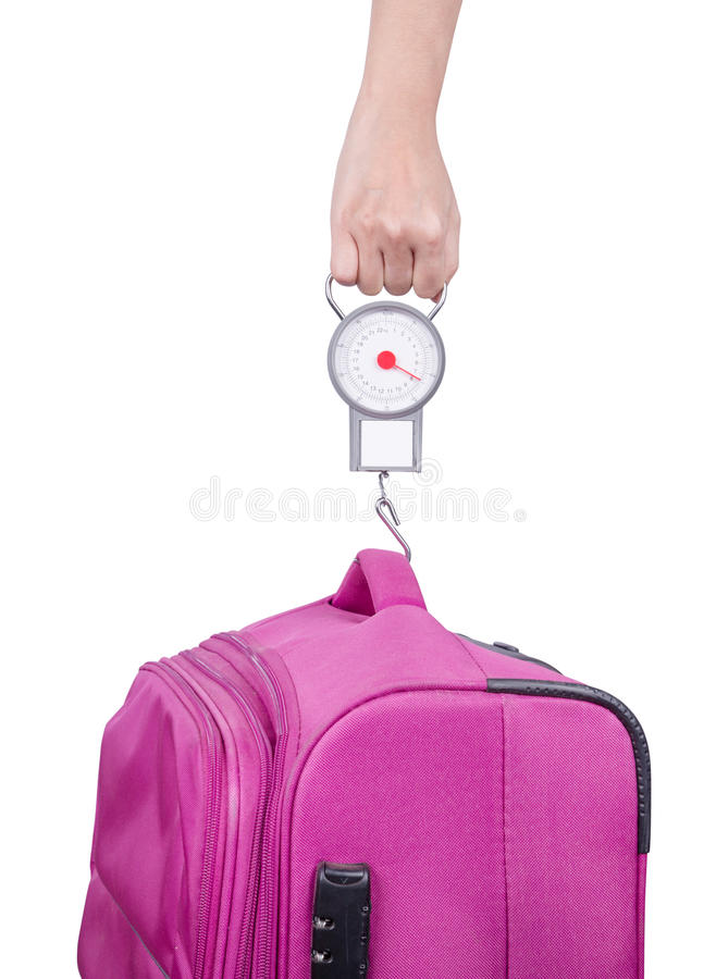 Passageiro que verifica o peso da bagagem com a escala antes do isola do voo fotos de stock royalty free
