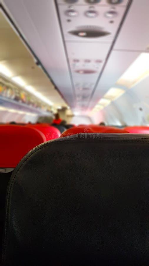 Passageiros no plano e na atmosfera do servi?o do pessoal no plano fotografia de stock