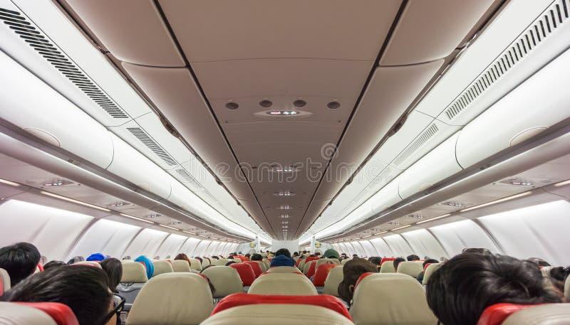 Passagerare ombord det kommersiella flygplanet arkivbilder