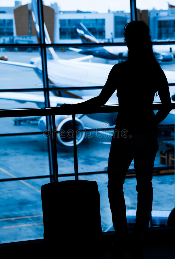 Passagerare på flygplatsen royaltyfri fotografi