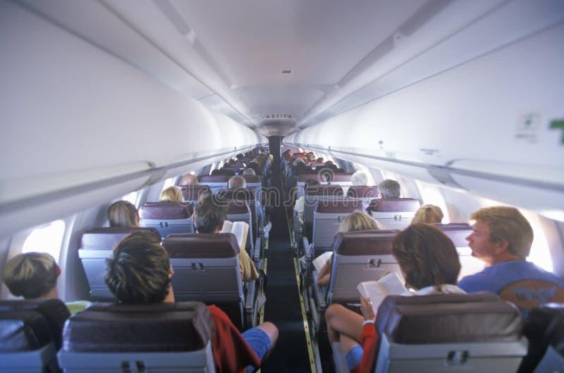Passagers de l'arrière de l'avion photo stock