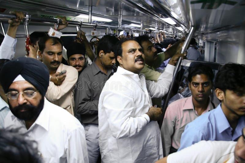Passagers de métro de Delhi image stock