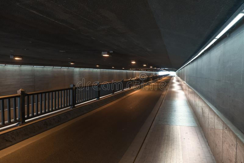 The passageway in the city, Perspective background. A passage of mystery light transportation construction line dirty underground road urban tunnel railroad stock images