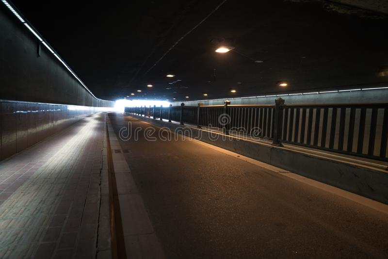 The passageway in the city, Perspective background. A passage of mystery light transportation construction line dirty underground road urban tunnel railroad royalty free stock photos