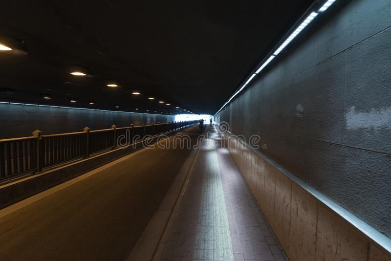 The passageway in the city, Perspective background. A passage of mystery light transportation construction line dirty underground road urban tunnel railroad royalty free stock images