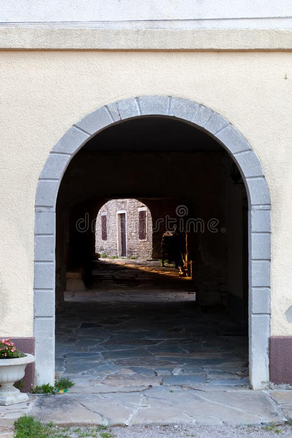 Passageway in old Mediterranean town Draguc - Istria, Croatia. Shot of passageway in old Mediterranean town Draguc - Istria, Croatia royalty free stock photos