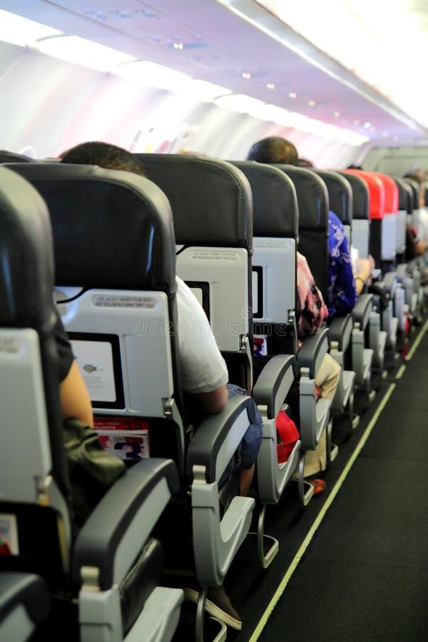 Passagiers in de Cabine van het Vliegtuig stock afbeeldingen