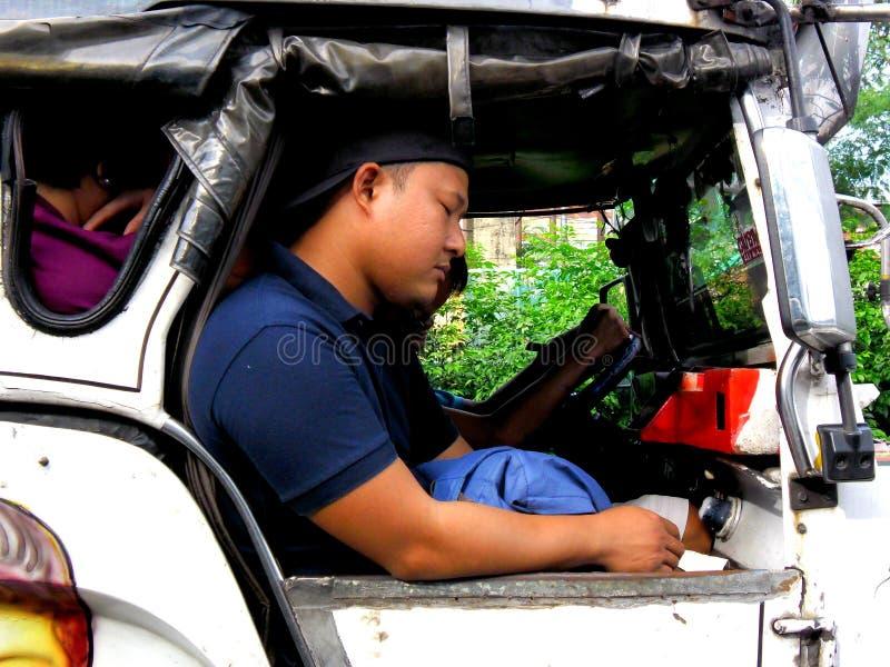 Passagiersslaap binnen een jeep stock foto
