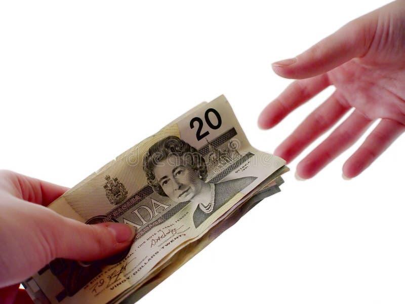 Passando o dinheiro fotografia de stock royalty free