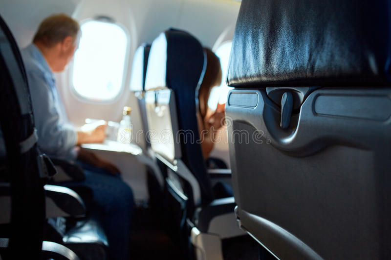 Passanger in aircraft cabin royalty free stock photo