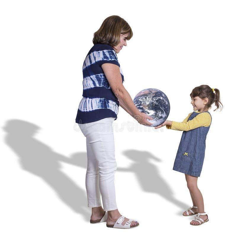 Passant la planète, d'une génération au prochain images libres de droits