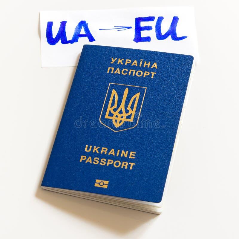 Passaporte biométrico ucraniano com a inscrição UA-EU em um fundo branco fotografia de stock
