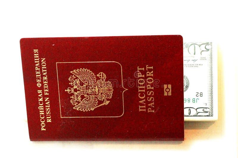 Passaporte do russo e dólares dos EUA isolados no fundo branco fotografia de stock