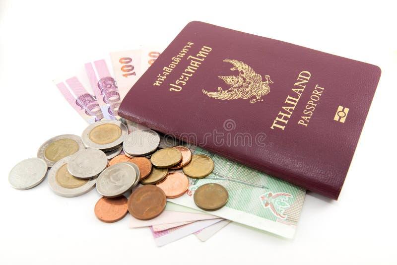 Passaporto della Tailandia e soldi tailandesi fotografia stock