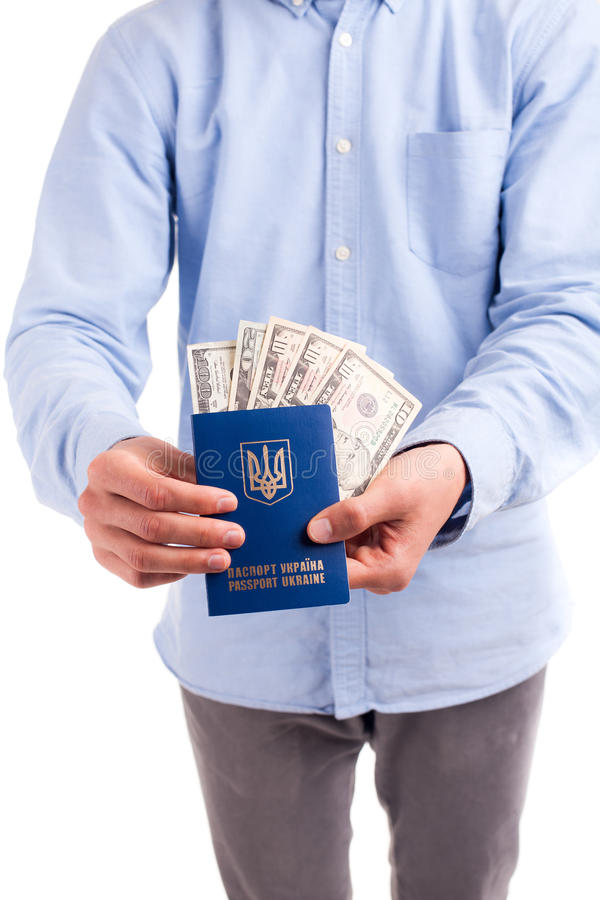 Passaporto internazionale dell'Ucraina con le banconote in dollari immagine stock libera da diritti