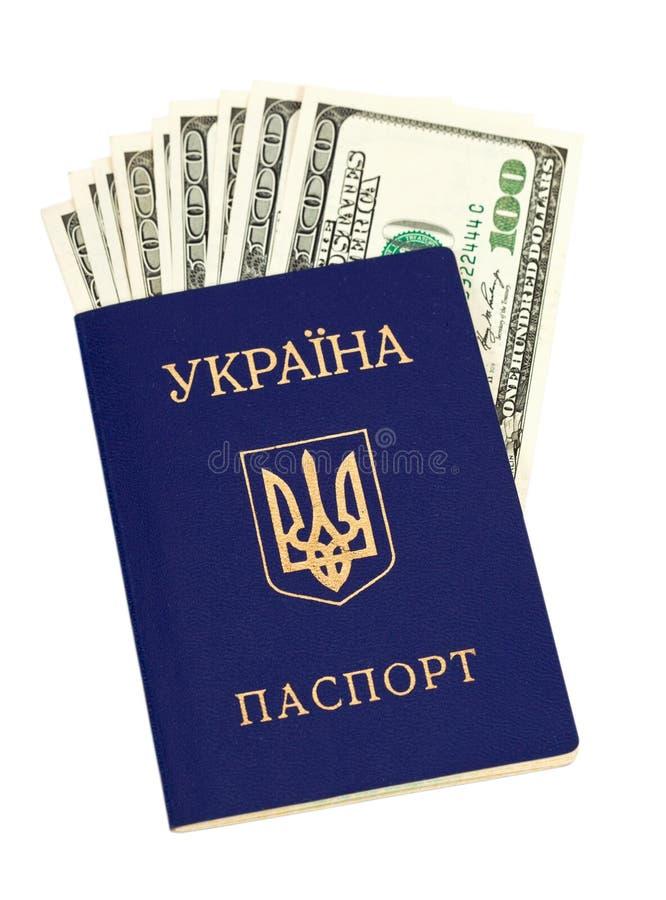 Passaporto ucraino e dollari US fotografia stock libera da diritti