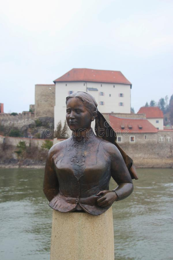 Bust of the poet and landlady Emerenz Meier on the quay of the Danube river in Passau, Germany. Passau, Bavaria, Germany - February 21, 2019: Bust of the poet stock image