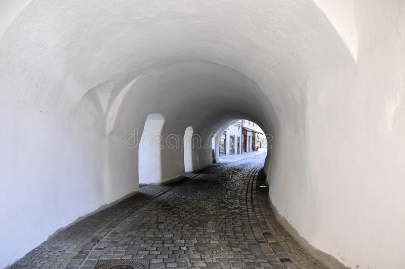 Passau (Germany) Steinweg. White tunnel on the cobbled Steinweg road, Passau (Germany royalty free stock image
