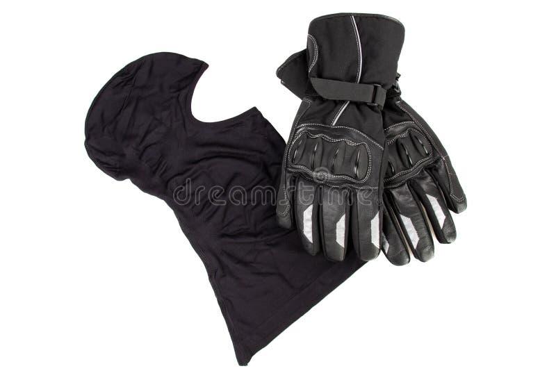 Passe-montagne et gants de noir de moto d'isolement à l'arrière-plan blanc image libre de droits