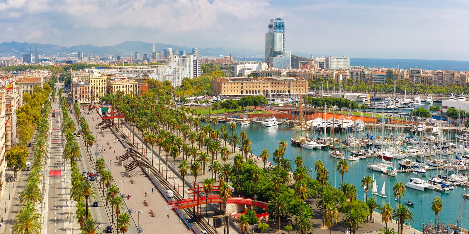 Passeig de Colom in Barcelona, Catalonia, Spain. Aerial panoramic view over Passeig de Colom or Columbus avenue, La Barceloneta and Port Vell marina from stock photo